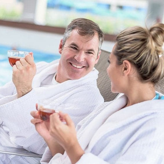 A man and a woman relaxing at the spa